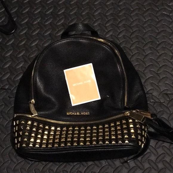 7f8bb7acb6fc Michael Kors Bags   Rhea Medium Studded Leather Backpack   Poshmark